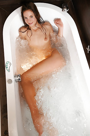 Sweet babe taking a bubble bath