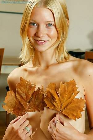 Blonde teeny having fun with leaves