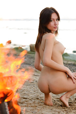 Cute model posing at the fireplace