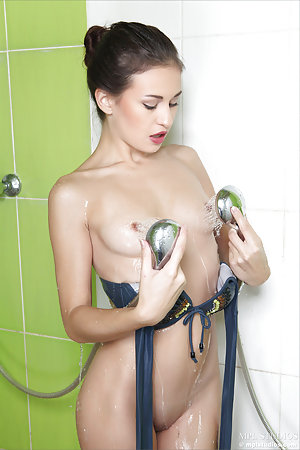 Tiny girl with small nipples takes a shower nude