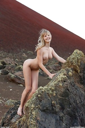 A trek in the mountainside in the nude