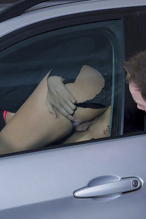 A blow job for her boyfriend by the car