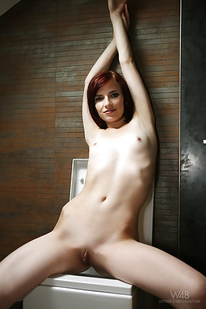 Redhead with tiny tits is showing us her pussy