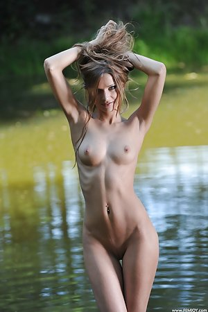 Brunette with blue eyes is naked in the lake