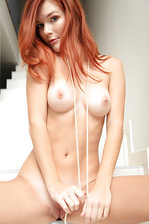 Redhead is walking down the stairs