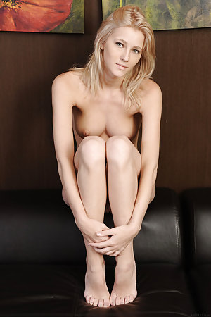 Sweet young blonde is on the sofa, naked