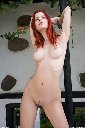 Redhead shows us her large natural tits
