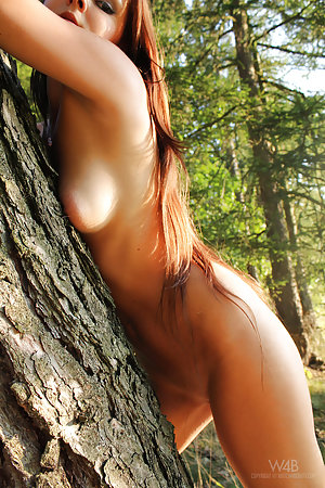 Fun loving little cutie is in the forest, naked