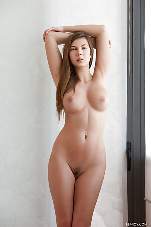 Busty thing is leaning against the sliding door