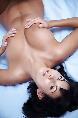 Top heavy model is naked on the bed