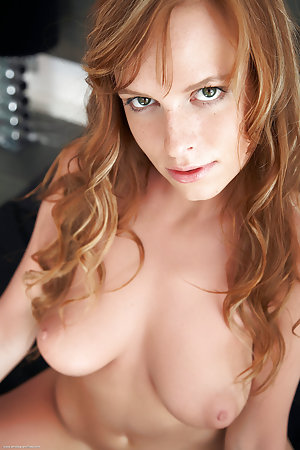 Redhead with a large pair of tits has some fun