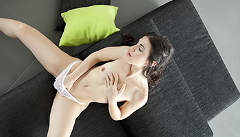 Spanish brunette strokes her perfect slit