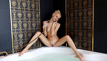 Petite blonde has a sensual shower