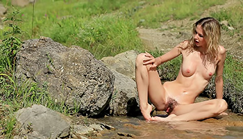 Nature loving tootsie skinny dips outdoors