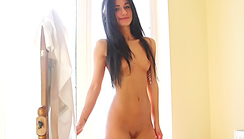 Brunette sexy raven naked in her room