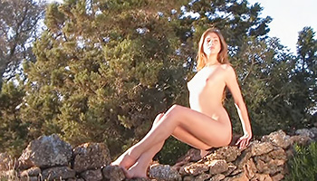 Hot babe is naked in the wild