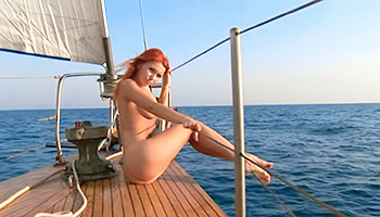 Naked redhead babe on the yacht