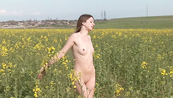 Sweet euro teen posing in a field