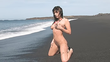 Brunette honey frolics on a beach