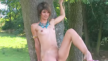 Short haired honey gets naked outside