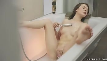 Fresh babe is masturbating in the shower