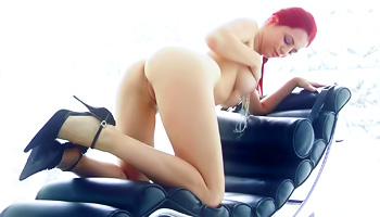 Smooth redhead snuggles her shaved snatch