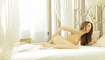 Angelic brunette babe pleases her vagina