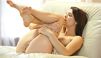 Lifting her legs up for sweet masturbation