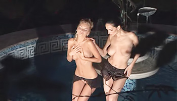 Two classy honeys tease each other