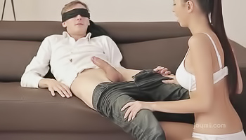 Busty brunette pleases blindfolded lad