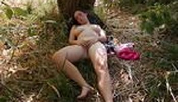 Big titty girl masturbating outdoors by a tree