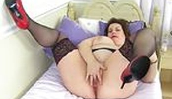 Fat mature from the UK plays with her boobs and pussy