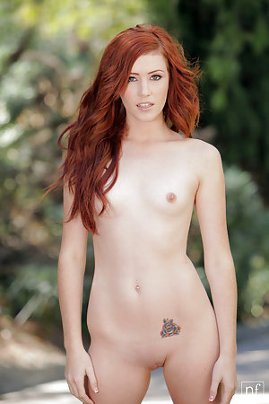 Absolutely adorable redhead babe posing outdoors
