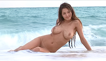 Erotic beauty poses on a beach