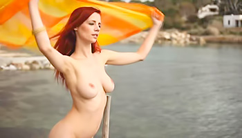 Redhead babe outdoors looking so sexy
