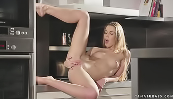Horny chick is masturbating in the kitchen