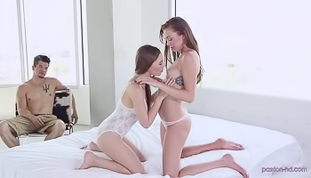 Two girls are licking one huge cock