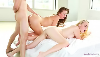 Two girls are having a steamy threesome