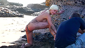 Blonde model poses nude on the beach