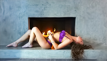 Fireplace warms her bare buns during masturbation