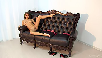 Big couch is there for her masturbation